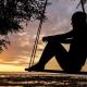 Woman Sitting on Swing Looking At Horizon