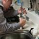 Man Fixing Leaky Sink
