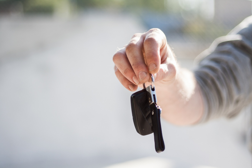 Hand with keys to a car