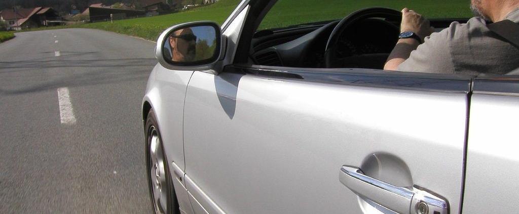 Rental car driving down the road